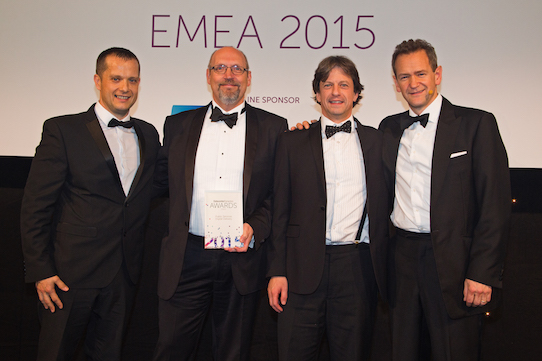 Ian Tasker (UIS) and Tony Collins (Cambridge Assessment), flanked by TV presenter Alexander Armstrong and a representative from CommScope, which sponsored the award category